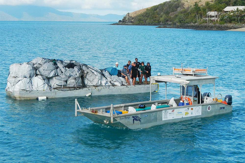Clean up the seas with Eco Barge Clean Seas. Image: Tourism and Events Queensland