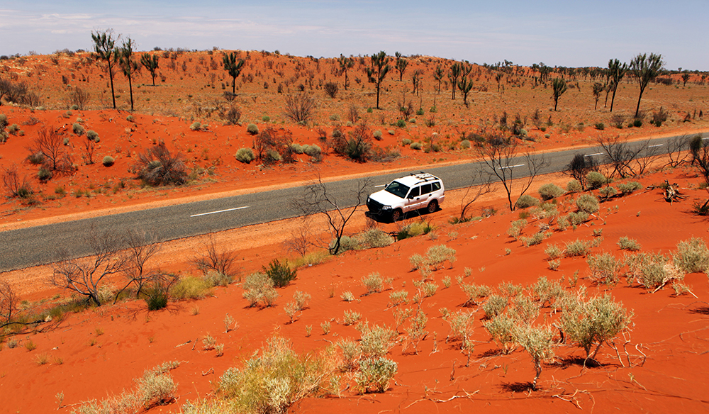 Australian red center landscape on a road from Uluru to Alice Springs.