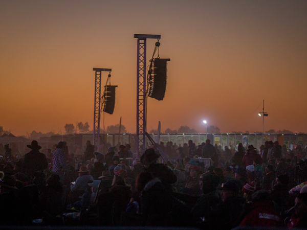 The Big Red Bash Festival coming to life as the sun sets in Birdsville.