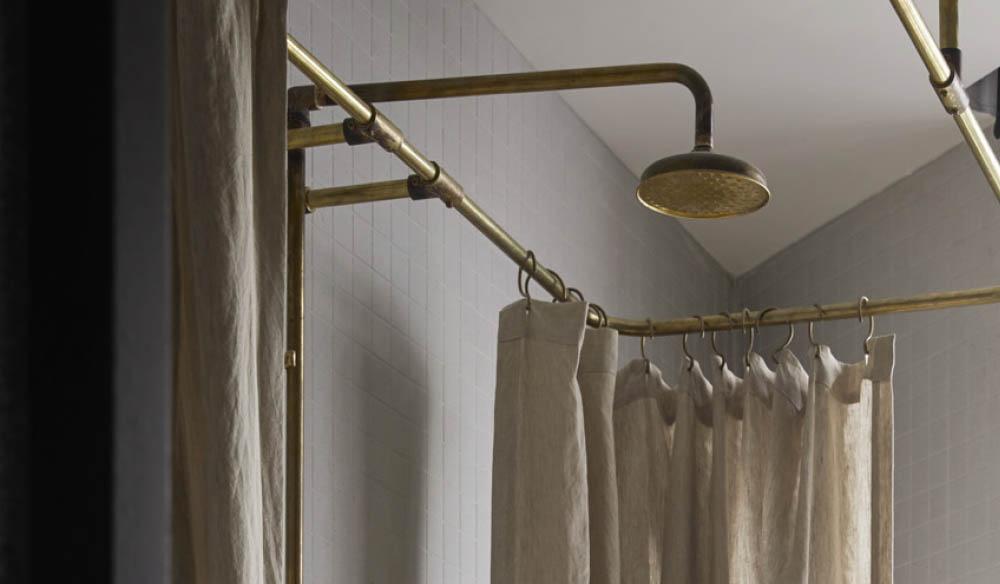 Raw brass bathroom fixtures strike the right tone