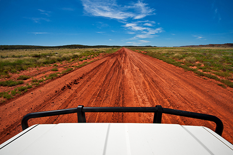 Red desert track in Central Australia.