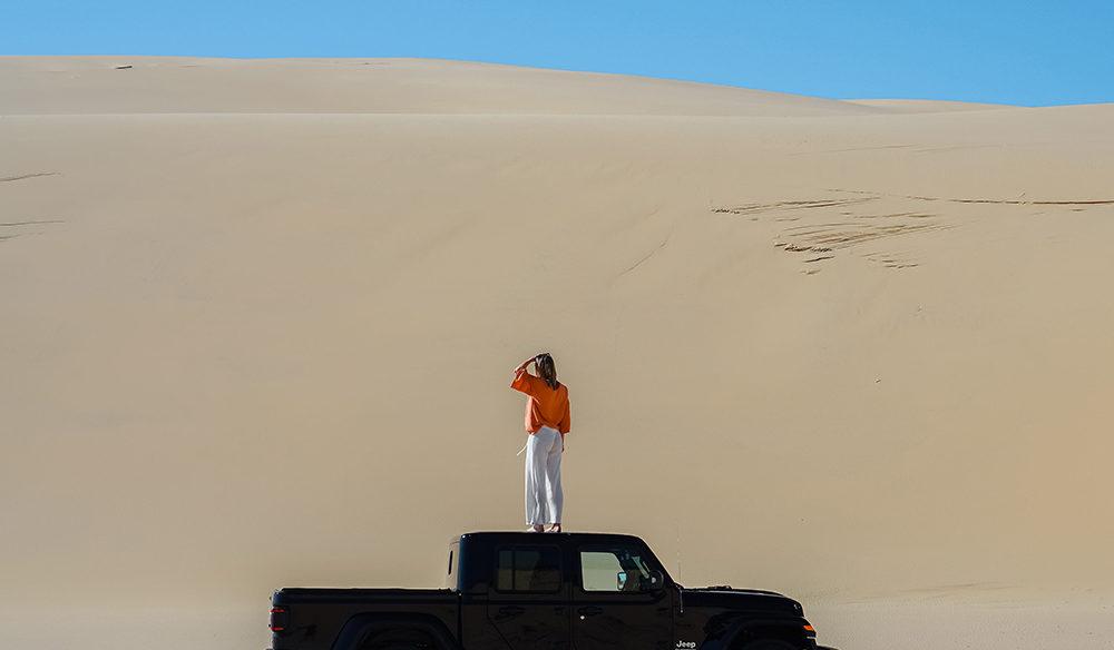 Woman standing on Jeep, Stockton Bight Sand Dunes