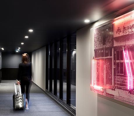 Midnight Hotel corridor featuring Tom Adair artwork, Canberra